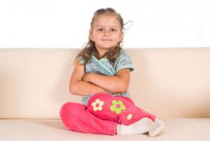 Child sitting legs to side